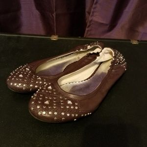 Purple flats with silver stud-like accents